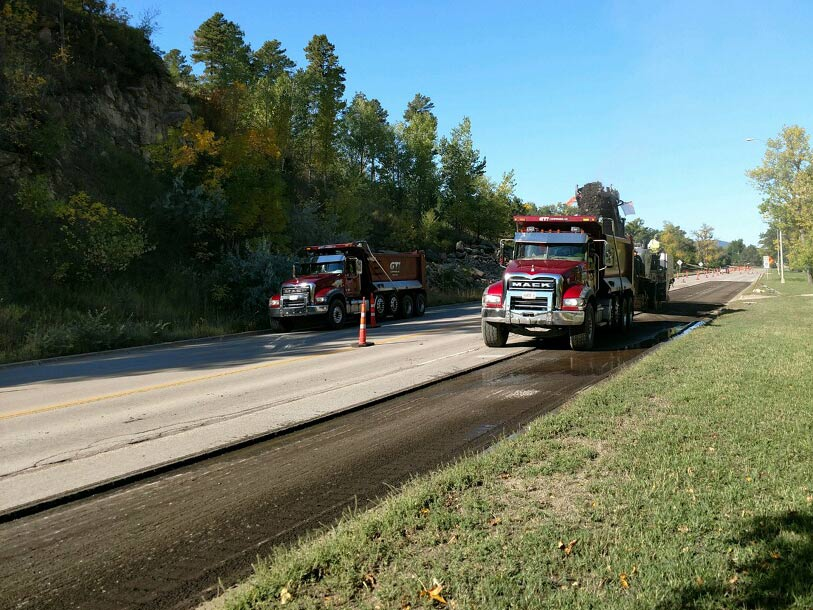 paving two trucks